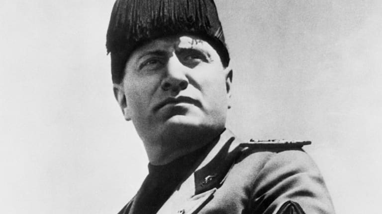 how did benito mussolini attempt to increase italy's power?-1